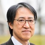 Portrait of Yoshihiro Kawaoka standing outdoors
