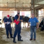 From left to right, outreach specialist Courtney Halbach, Professor Nigel Cook, and owner Mark Keller at Kellercrest Holsteins in Mount Horeb, Wisconsin. This summer, The Dairyland Initiative helped the farm evaluate their needs for transitioning from a naturally ventilated barn to a mechanically ventilated barn.