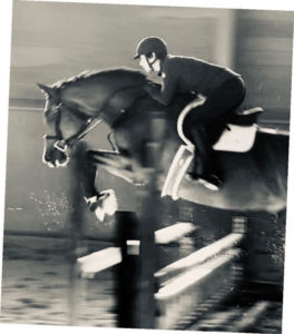 Rider and owner Mary Brown guides Newman, a 9-year-old Canadian Sport Horse, over a jump